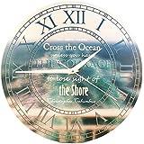 """Wanduhr – """"Du kannst das Meer niemals überqueren, wenn du nicht den Mut hast, die Küste aus den Augen zu verlieren"""" (28 cm)"""