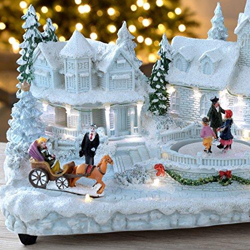 Christmas Ice Skating Rink Decoration: WeRChristmas Pre-Lit Polyresin Village Scene With Skating