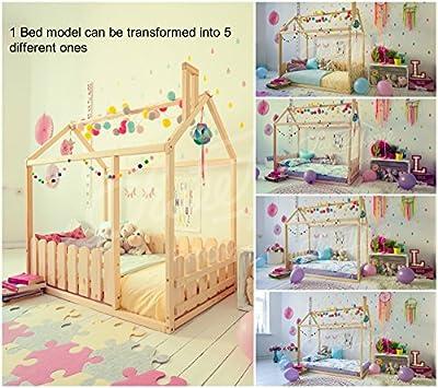 Cama de la casa Montessori, colchón no está directamente en el piso. Con valla.