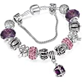A 925 silver bracelet adorned with Pandora elements, beads, roses and a silver crown with a pendants shaped like a crystal ba
