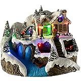WeRChristmas Pre-Lit LED Christmas House Scene con girante Pattinaggio per Bambini, 22cm