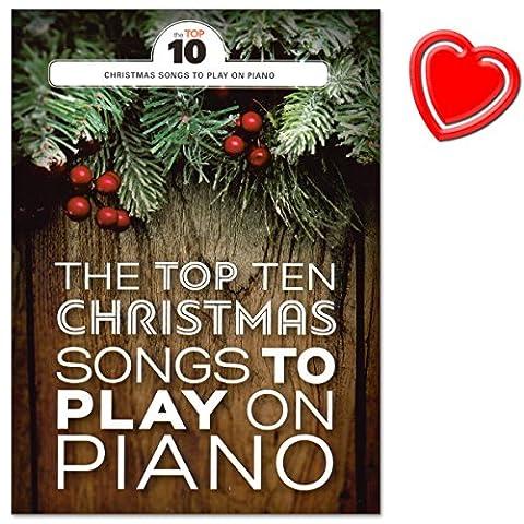 The Top Ten Christmas Songs To Play On Piano - Noten für Klavier, Gesang und Gitaare - Weihnachtslieder mit bunter herzförmiger Notenklammer