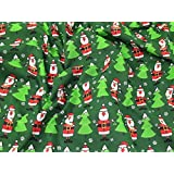 Père Noël et arbres de Noël en polycoton imprimé Vert Tissu de robe–au mètre