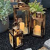 Mojawo Set di 3 Lanterne da Giardino, in Acciaio Inox Color Oro Rosa/Rame, Altezza 22/32/46 cm, Design Elegante + 3 luci LED a Goccia e 3 Candele a LED in Vera Cera