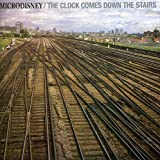 Songtexte von Microdisney - The Clock Comes Down the Stairs