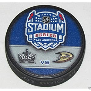 2014 Stadium Series Dueling NHL Souvenir Puck – Ducks vs. Kings