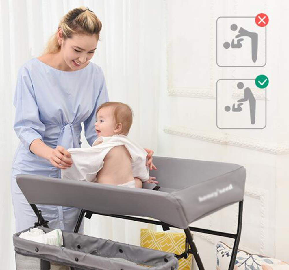 Baby Changing Table Baby Storage Bath Tub Unit Station Dresser Foldable Cross Leg Style AA-SS-Baby Changing Table 【Two in One Design】This baby changing table can be used as baby massaging table as 【Stable Construction】Non-skid feet covers and a sturdy frame keep the table stable and prevent movement. 【Waterproof Material】The surface of the top table is made of durable and wearable Oxford cloth and it can be used for a long period. 3