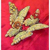 Tris di farfalle in ceramica.