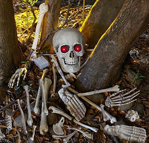 Skelett Gebeine Totenschädel mit Leuchtaugen, Sound und Bewegungsmelder 18 teiliges Horror Deko Schocker Set reagiert auf Bewegung und beginnt mit den Augen zu blinken und zu lachen wenn jemand den (Deluxe Set Grabstein)