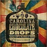 Songtexte von Carolina Chocolate Drops - Dona Got a Ramblin' Mind
