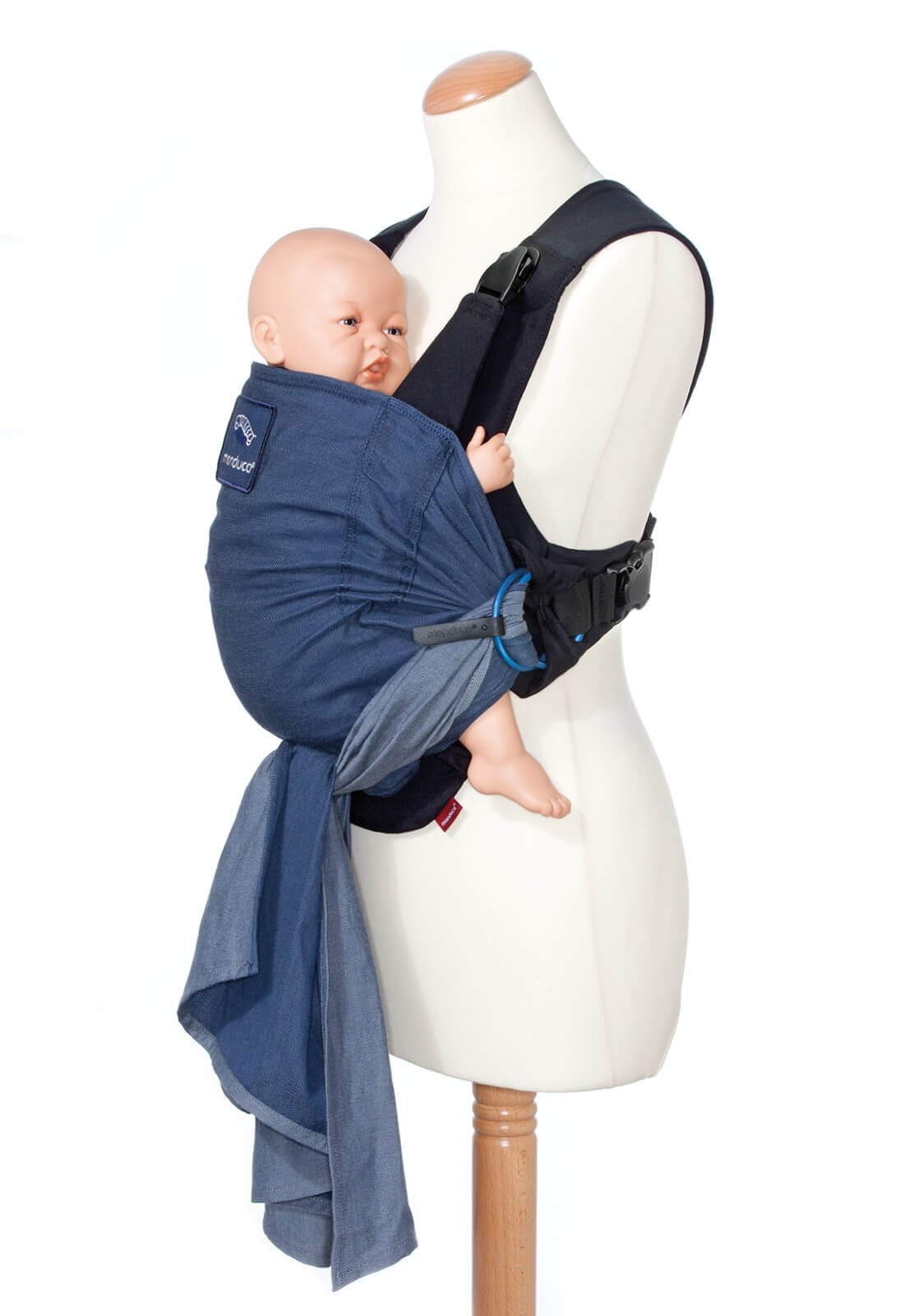 manduca Duo - Hybrid of Baby Carrier and Sling, Innovative Click &Tie System, Baby Slip-Through-Protection, Removable Hip Belt, Organic Cotton and Mesh, from Birth to 15kg (Blue) Manduca Optimized as front carrier, with slip-through protection (secure fit for your baby), supports the M position, for newborns from birth to infants up to 15 kg Especially popular with first-time parents who find it difficult to choose between a sling and a comfort carrier with buckles. Easy to use, illustrated instructions Detachable hip belt, which is only zipped on when needed (up to 140cm circumference without belt extension). Ideal for mothers with sensitive belly and after cesarean section, good weight distribution, comfortable on the shoulders. 5