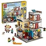 LEGO Creator 3in1 31097 Negozio degli Animali & Café, Set di costruzioni 3in1 con Negozio degli Animali & Café o una Banca a più Piani o una Strada con Mercato con Tram, per Ragazzi dai 9 Anni in su