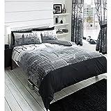 Perfetta per qualsiasi camera da letto moderno o contemporaneo, questo copripiumino reversibile presenta un design nero città sorprendente. Stampa con un paesaggio urbano astratto in tonalità di bianco, nero e grigio con un design a righe sul...