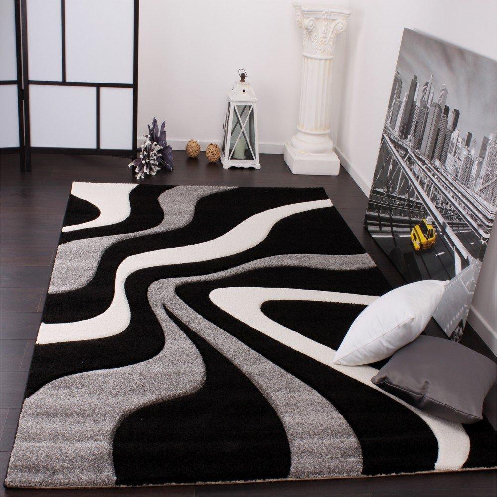 Tapis de créateur aux contours découpés motif vagues en gris noir ...