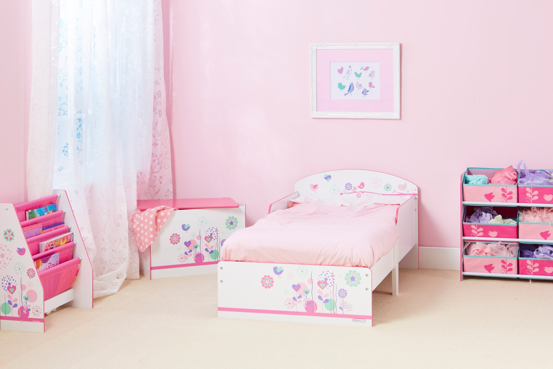 Flowers and Birds Kids Toddler Bed by HelloHome  Ideal transition from cot to bed - make the move to her first big bed magical with the Flowers and Birds toddler bed from HelloHome Takes cot bed size mattress - 140cm (l) x 70cm (w). Mattress not included. Assembled size (h)59, (w)77, (l)142cm Suitable for 18 months to 5 years this pink kids' bed is perfect for your little toddler! 6