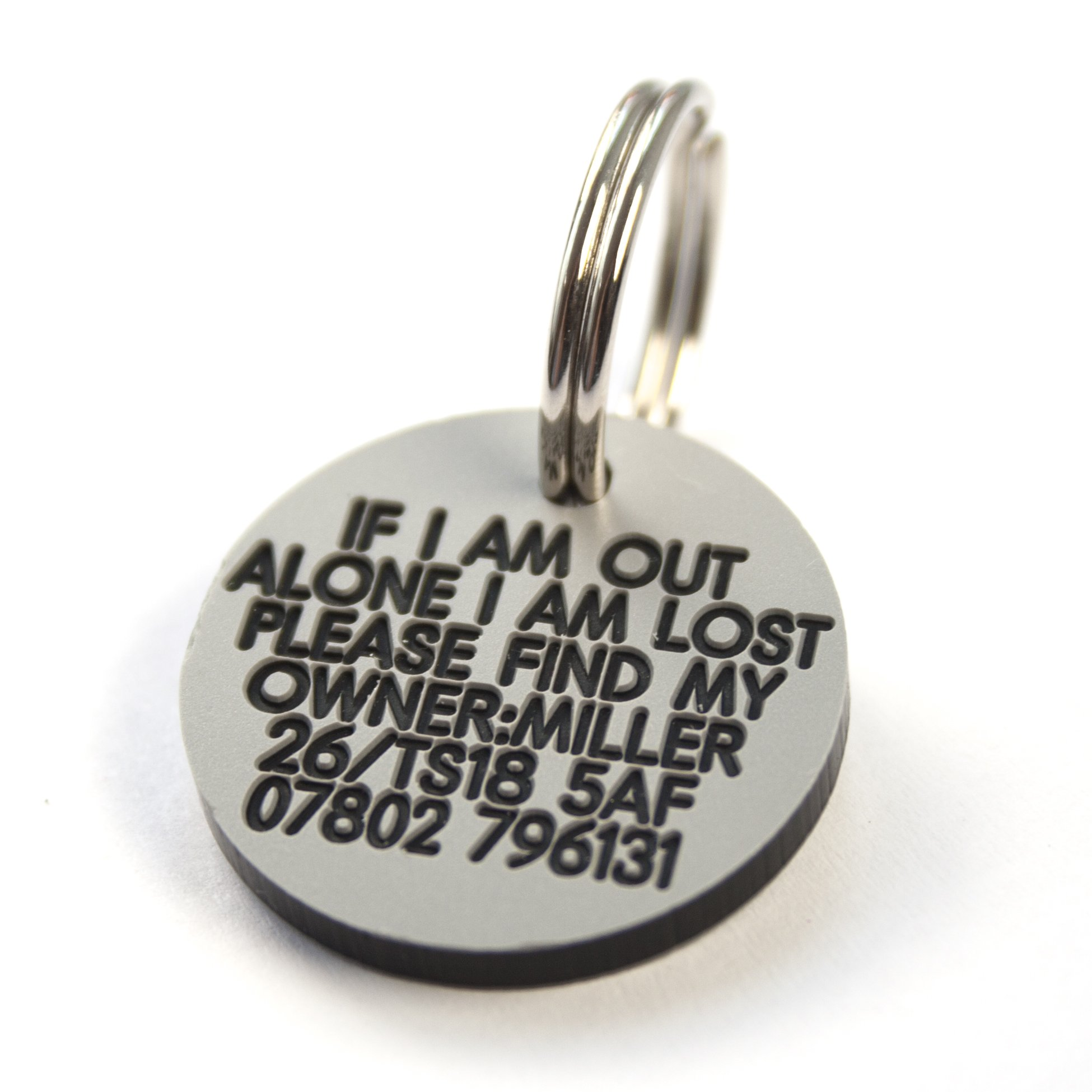 Engraving Studios Deeply engraved silver plastic 27mm circular dog tag