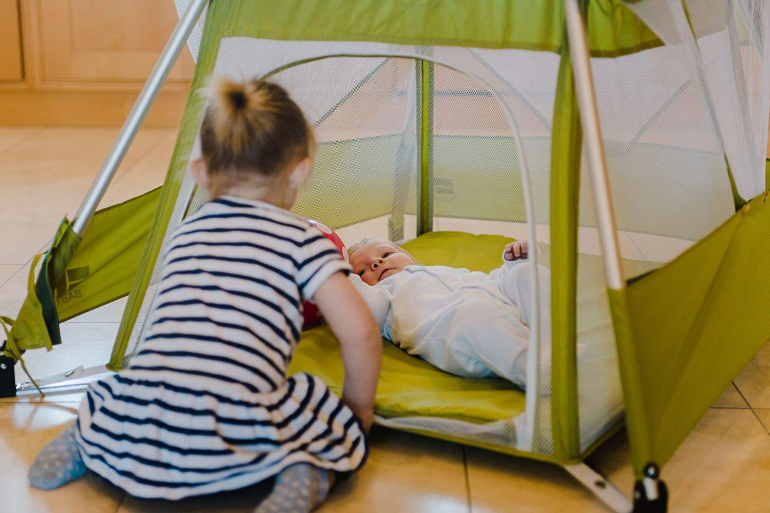 BabyHub Travel Cot with Circus Tepee and Mosquito Net, Green BabyHub A travel cot, mosquito proof space and reuse as a play tepee Lightweight and easy to put up and fold in seconds Includes extra padded seam-free mat for comfort 4
