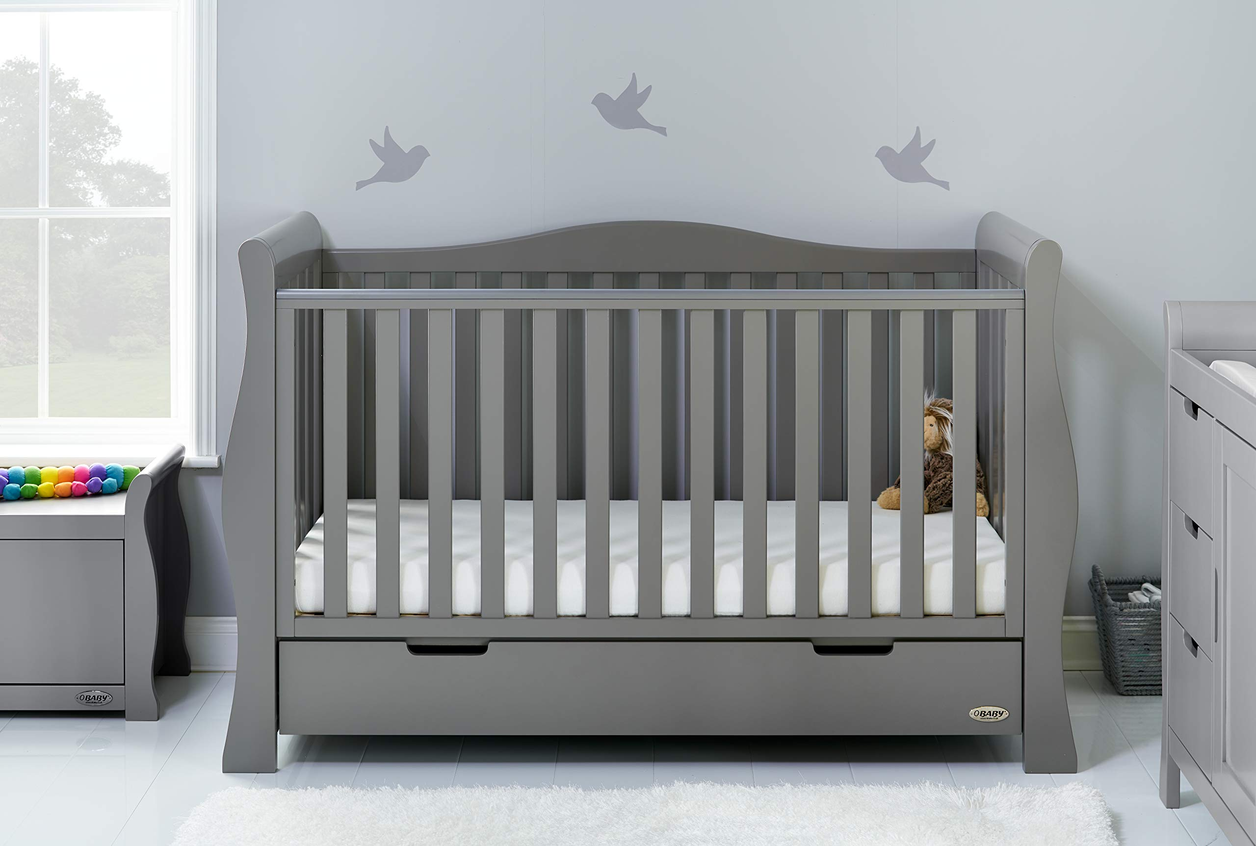 Obaby Stamford Sleigh Luxe Cot Bed - Taupe Grey Obaby Adjustable 3 position mattress height Bed ends split to transforms into toddler bed Includes matching under drawer for storage 1