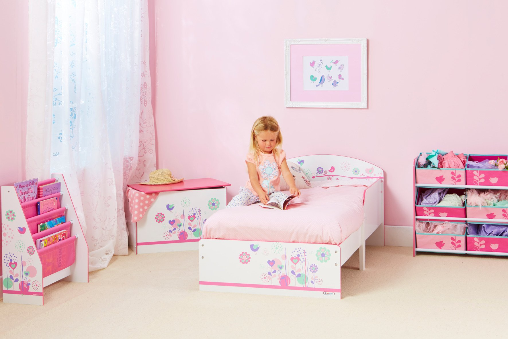 Flowers and Birds Kids Toddler Bed by HelloHome  Ideal transition from cot to bed - make the move to her first big bed magical with the Flowers and Birds toddler bed from HelloHome Takes cot bed size mattress - 140cm (l) x 70cm (w). Mattress not included. Assembled size (h)59, (w)77, (l)142cm Suitable for 18 months to 5 years this pink kids' bed is perfect for your little toddler! 5
