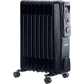 de094a2ac07 Portable 9 Fin 2kw Electric OIL FILLED RADIATOR Heater  Amazon.co.uk ...