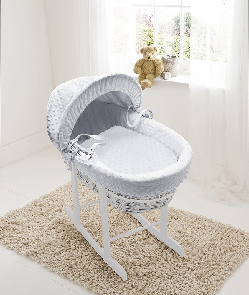 White Dimple White Wicker Moses Basket & Deluxe White Rocking Stand Elegant Baby Suitable from newborn for up to 9kg, this Moses Basket uses Easy-care Poly Cotton with a soft padding surround Suitable from newborn to 9 months It also includes a comfortable mattress and an adjustable hood perfect to create a cosy sleeping space for your precious little one 1