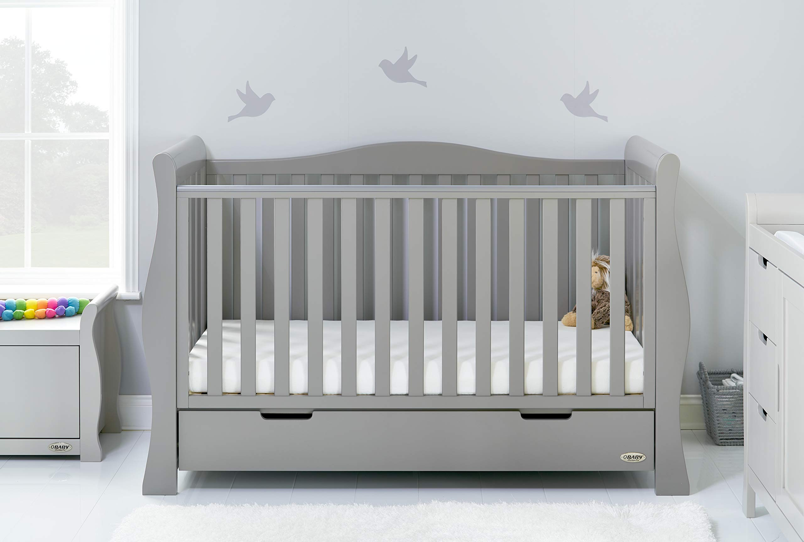 Obaby Stamford Luxe Sleigh Cot Bed, Warm Grey Obaby Adjustable 3 position mattress height Sides remove to transform into toddler bed Includes matching under drawer for storage 1