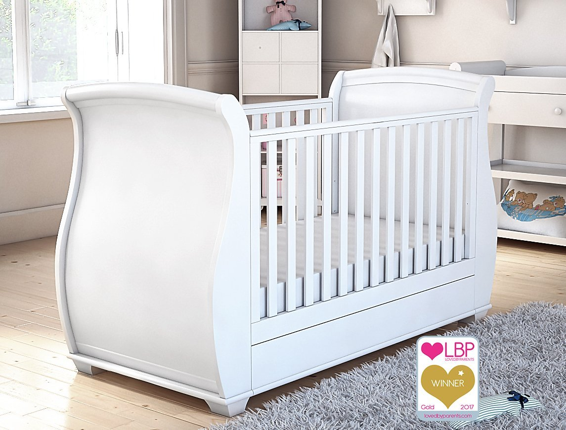Babymore Bel Sleigh Cot Bed Dropside with Drawer (White)  Magnificent sleigh with appealing look of grandeur and solidity. Easily convert to junior bed/sofa/day bed, Meet British and European safety standards Single handed drop side mechanism allow easy access to your baby. 2