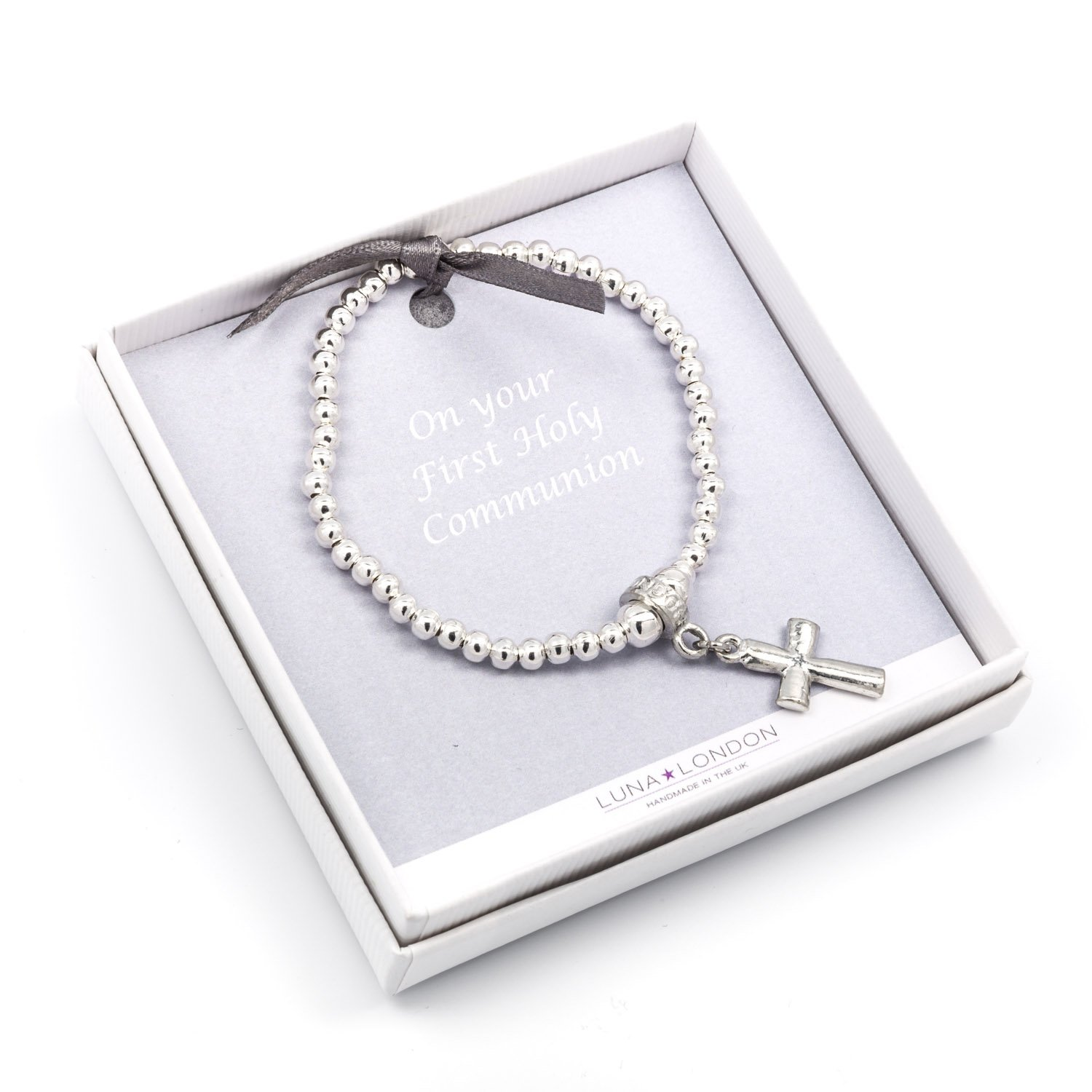 Metal Planet Ltd First Holy Communion silver plated bead bracelet, Childsize. Featuring a pewter cross design in smart…