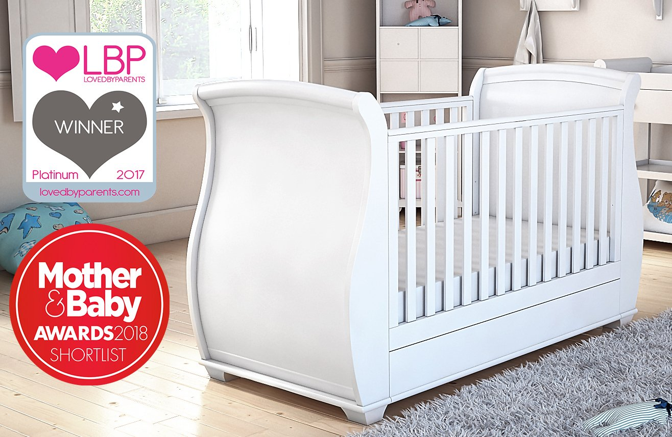 Babymore Bel Sleigh Cot Bed Dropside With Drawer (White Finish) + FREE FOAM MATTRESS  Easily convert to junior bed/sofa/day bed, Meet British and European safety standards; Single handed drop side mechanism allow easy access to your baby Protective Teething rail on top of both sides. Full drawer on runner provide extra storage. 2