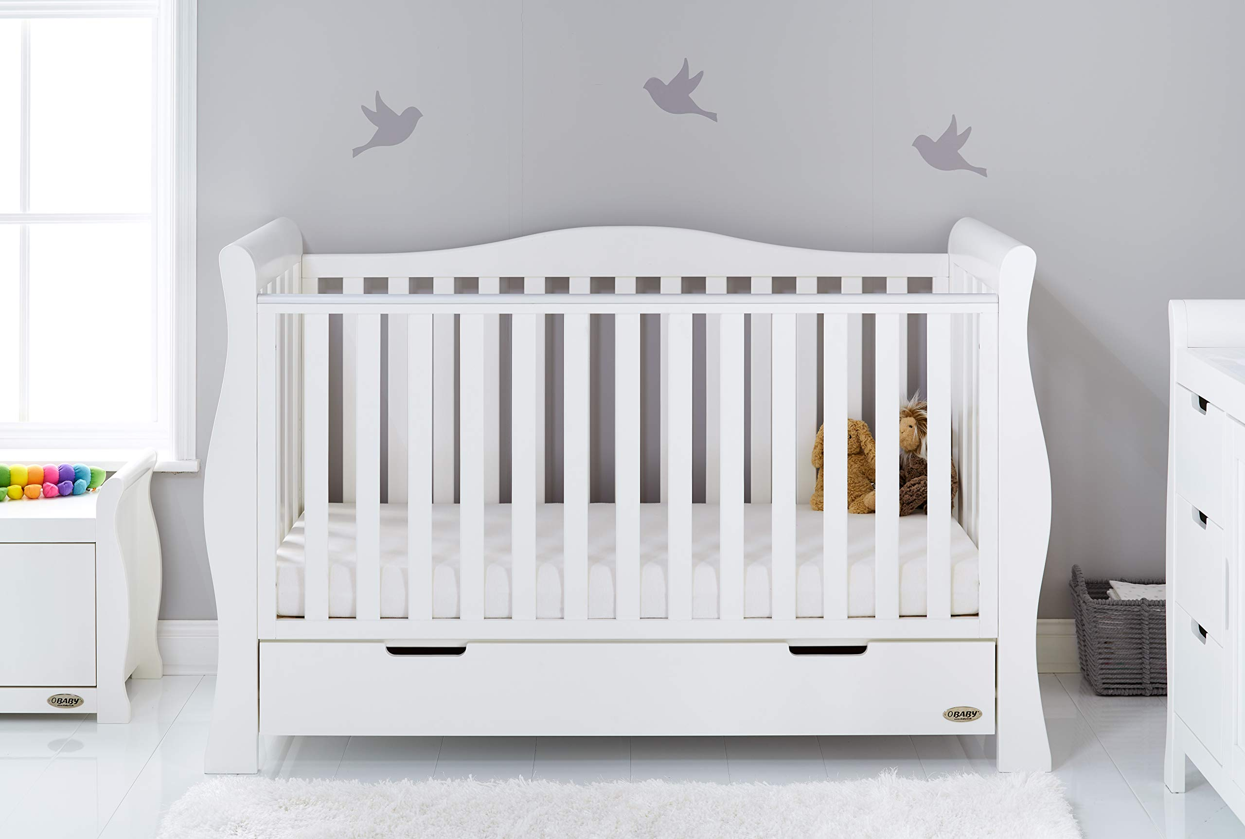 Obaby Stamford Sleigh Luxe Cot Bed - White Obaby Adjustable 3 position mattress height Bed ends split to transforms into toddler bed Includes matching under drawer for storage 1