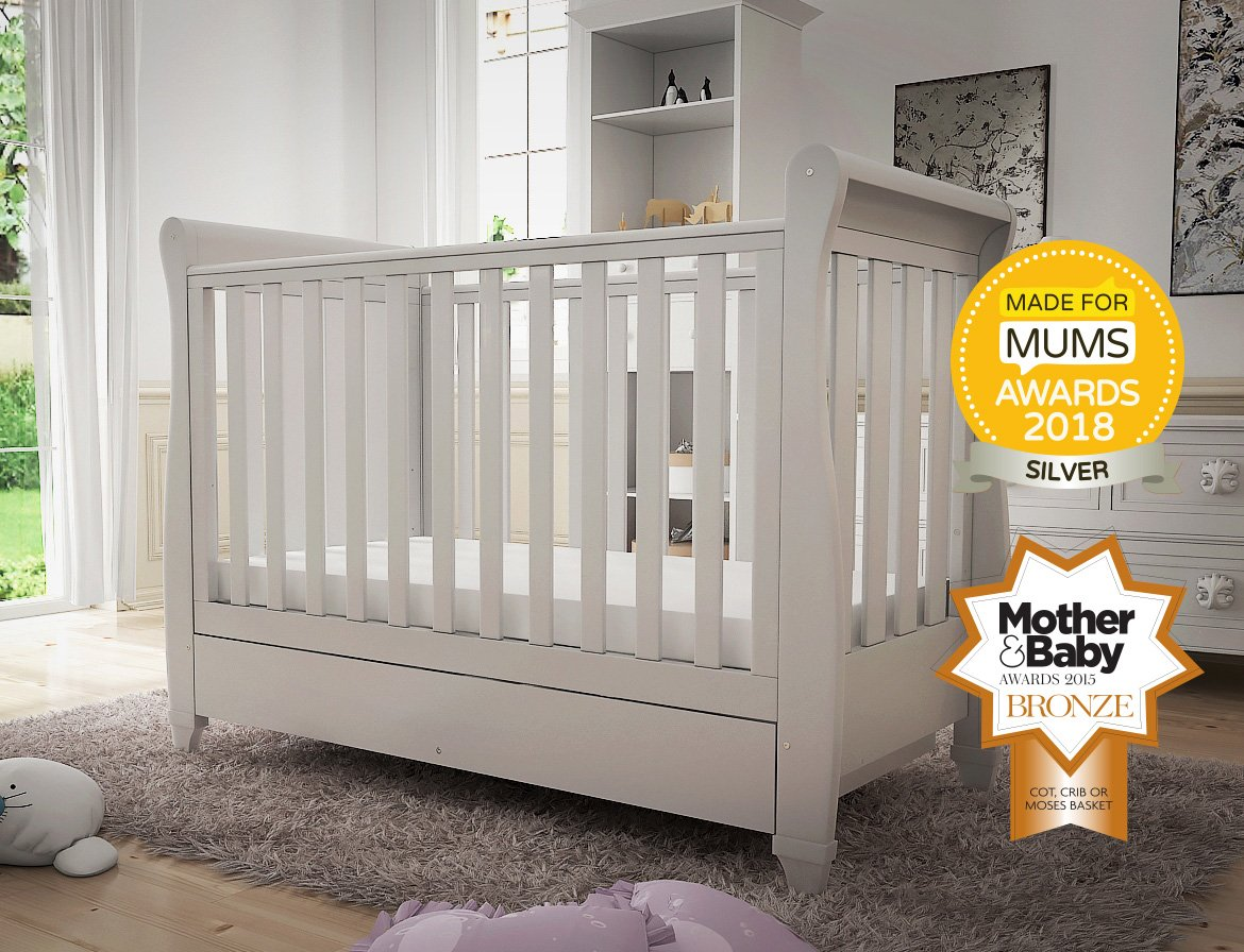 Babymore Eva Sleigh Cot Bed Dropside with Drawer (White Finish) + FOAM MATTRESS  Easily convert to junior bed/sofa/day bed, Meet British and European safety standards; Single handed drop side mechanism allow easy access to your baby Protective Teething rail on top of both sides. Full drawer on runner provide extra storage 2