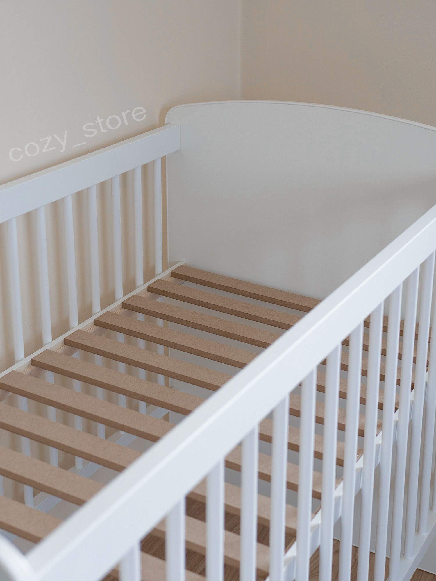 SOCOZY®   White Solid Pine Wood Baby Cot Bed I Free Healthy Coconut&BUCKWHEAT Mattress I Bed for Baby   3 Mattress Positions   ECO Paint   Minimalistic   120x60 SOCOZY ✔ HEALTH your growing child is the most important for us - The bed is made of ecological board and pine wood and the cot is covered with non-toxic lacquers ✔ ENJOY the view of the child playing in the cot and have a moment to yourself - as mom you deserve it more than anyone else ✔ GIVE YOUR CHILD a peaceful and helathy sleep - Coconut mat provides a flat, hard but also elastic support for the body while sleeping, perfect air circulation and humidity control. The mat is ecological. 3