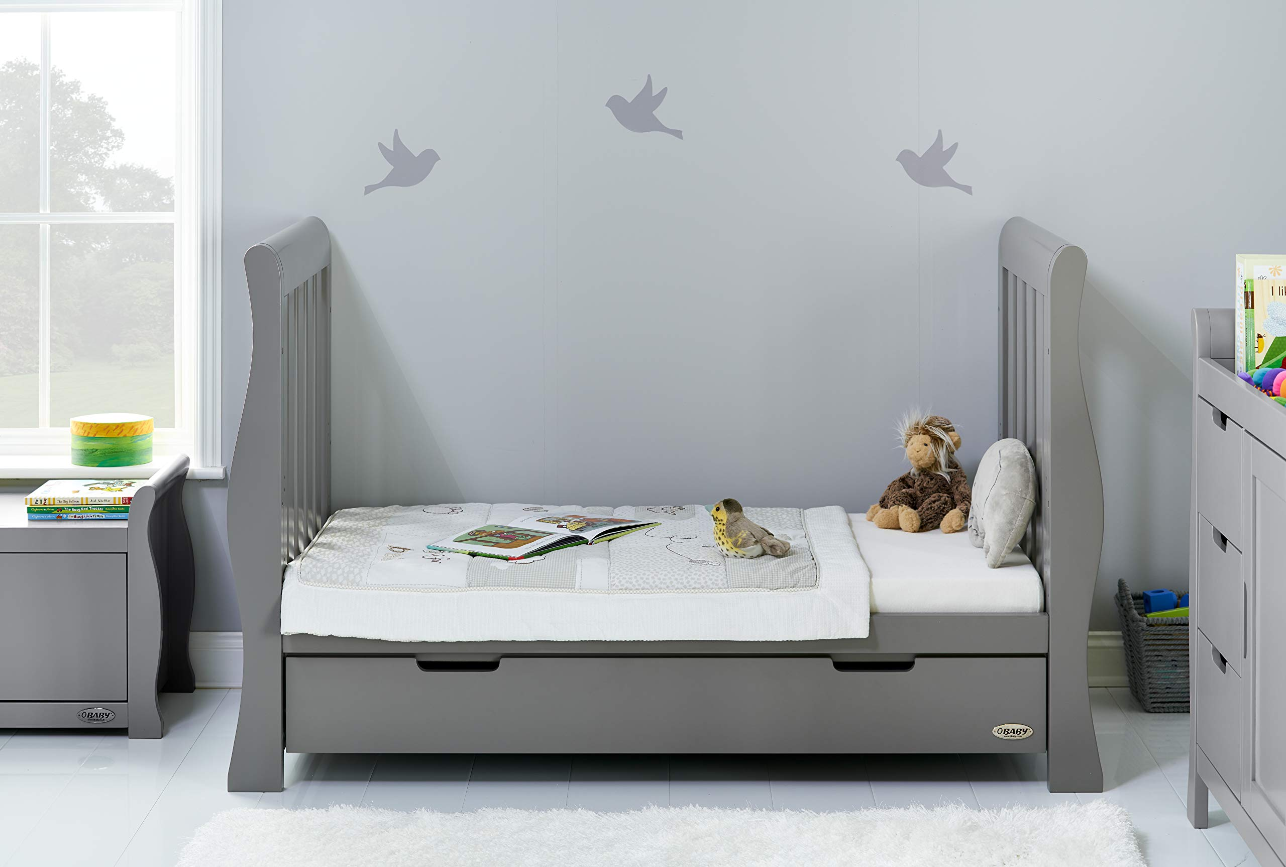Obaby Stamford Sleigh Luxe Cot Bed - Taupe Grey Obaby Adjustable 3 position mattress height Bed ends split to transforms into toddler bed Includes matching under drawer for storage 3