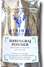 Intrinsic Bhringraj Powder for Hair Growth 100 g with powder particles containing natural Bhringraj oil for hair.