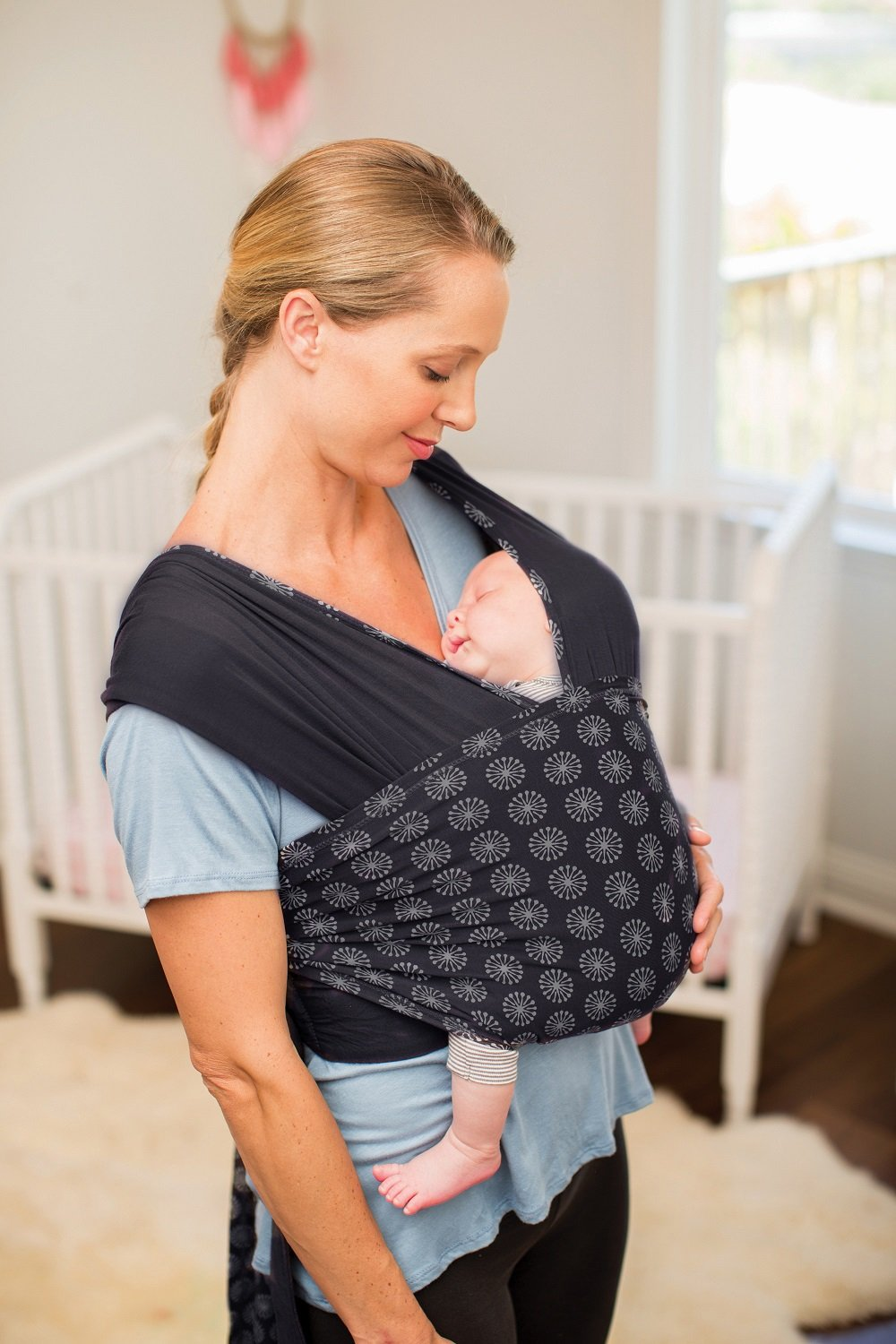 Infantino Together Pull-On Knit Carrier™ Infantino The together carrier features the comfort of a wrap, with an easy-on design The soft, stretchy fabric is gentle on little ones while providing complete, ergonomic support Adjustable back support evenly distributes the weight and makes the carrier the perfect option for most body types 2