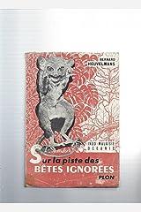 SUR LA PISTE DES BETES IGNOREES Paperback