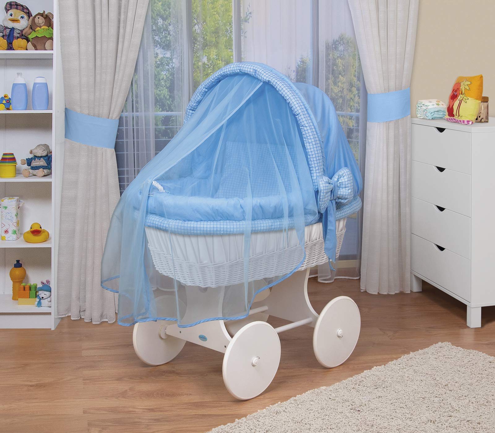 WALDIN Baby wicker cradle,Moses basket,44 models available,white painted stand/wheels,textile colour blue/squared  For more models and colours on Amazon click on WALDIN under the title Bassinet complete with bedding and stand Certified to safety standard EN 1130-1/2 2