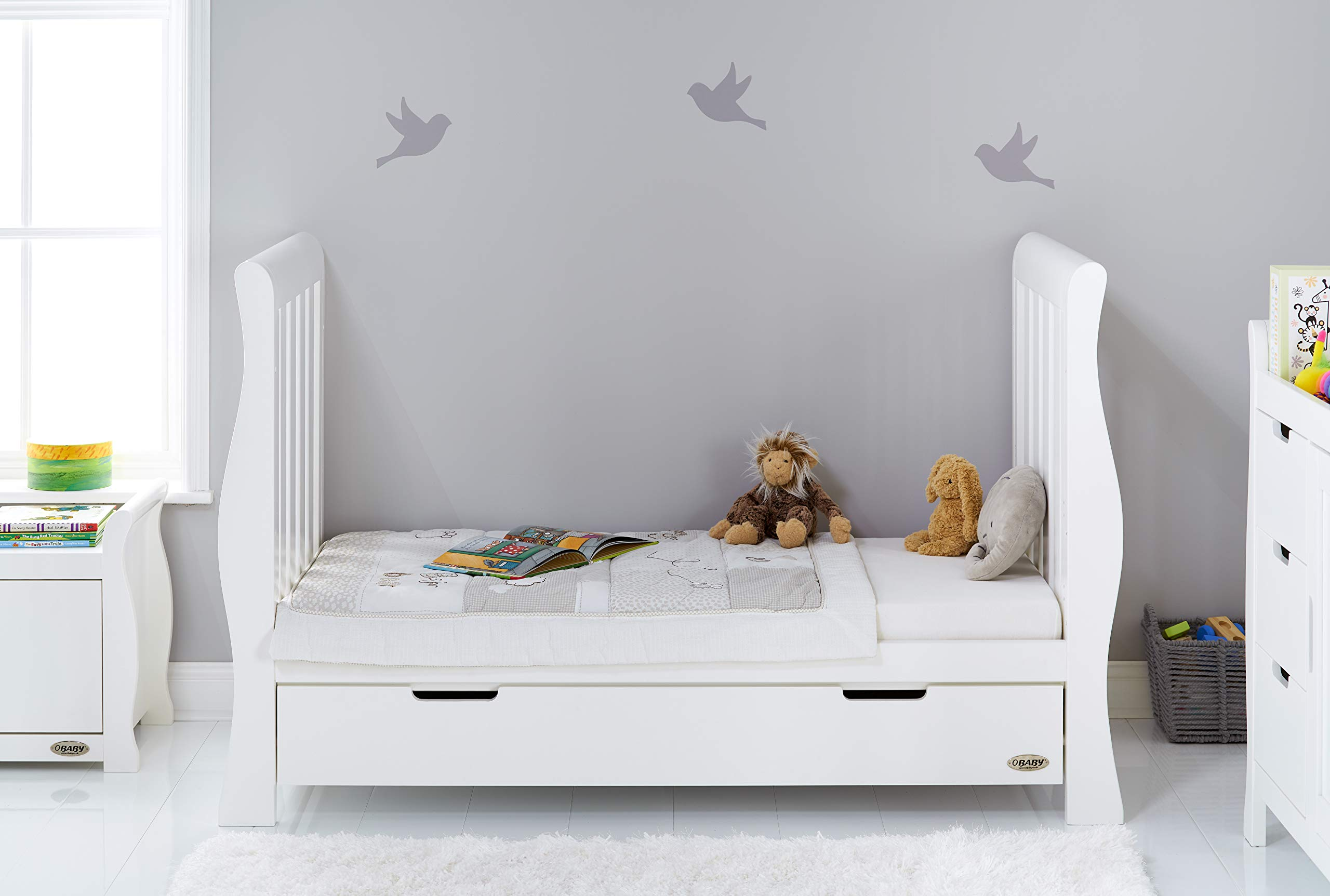 Obaby Stamford Sleigh Luxe Cot Bed - White Obaby Adjustable 3 position mattress height Bed ends split to transforms into toddler bed Includes matching under drawer for storage 3