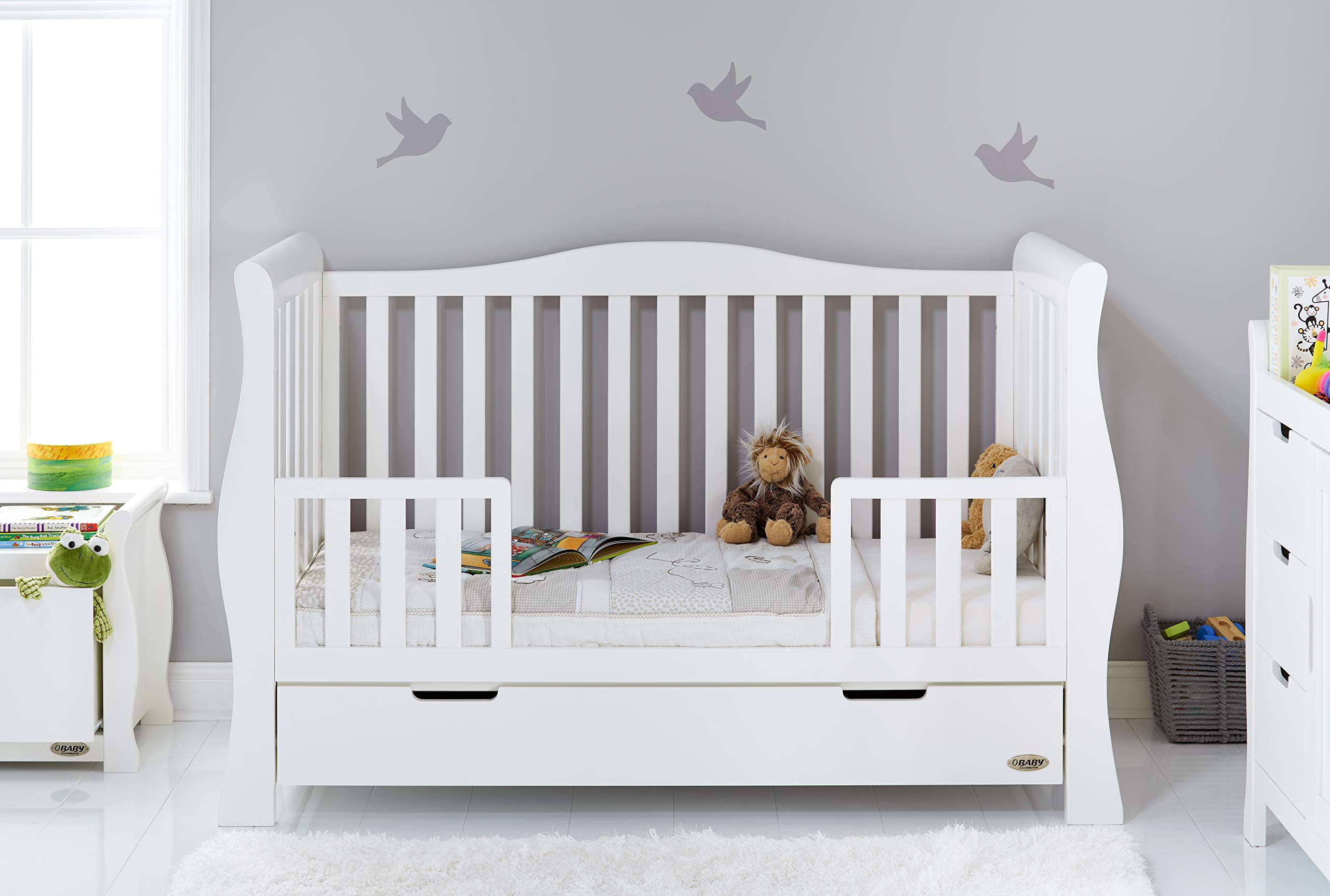 Obaby Stamford Sleigh Luxe Cot Bed - White Obaby Adjustable 3 position mattress height Bed ends split to transforms into toddler bed Includes matching under drawer for storage 2