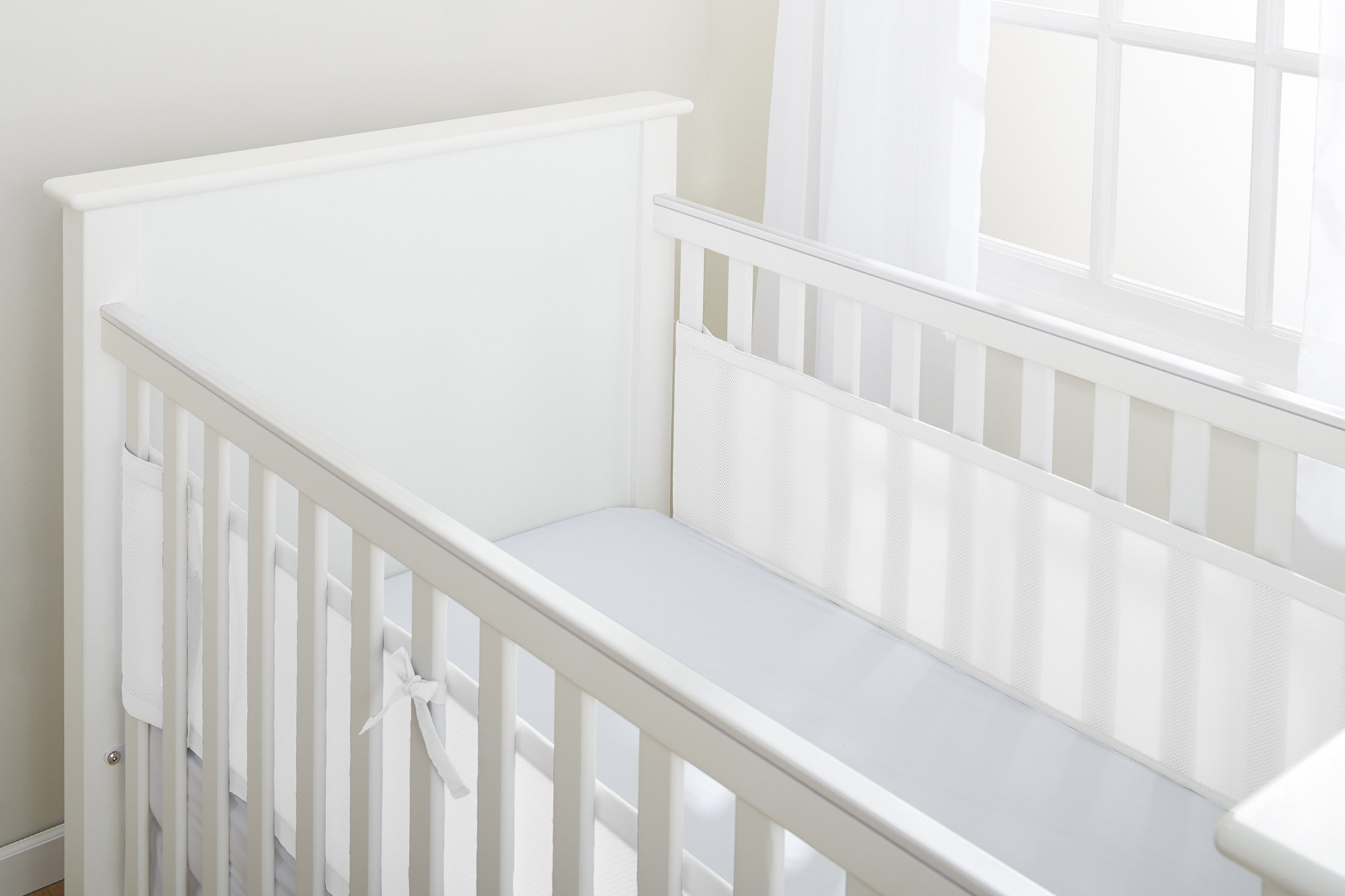 BreathableBaby 2 Sided Cot Mesh Liner (White Mist) BreathableBaby Suitable for solid end slatted cots Reduces the risk of suffocation with its breathable mesh material Design is soft and padded keeping little limbs safely inside 3