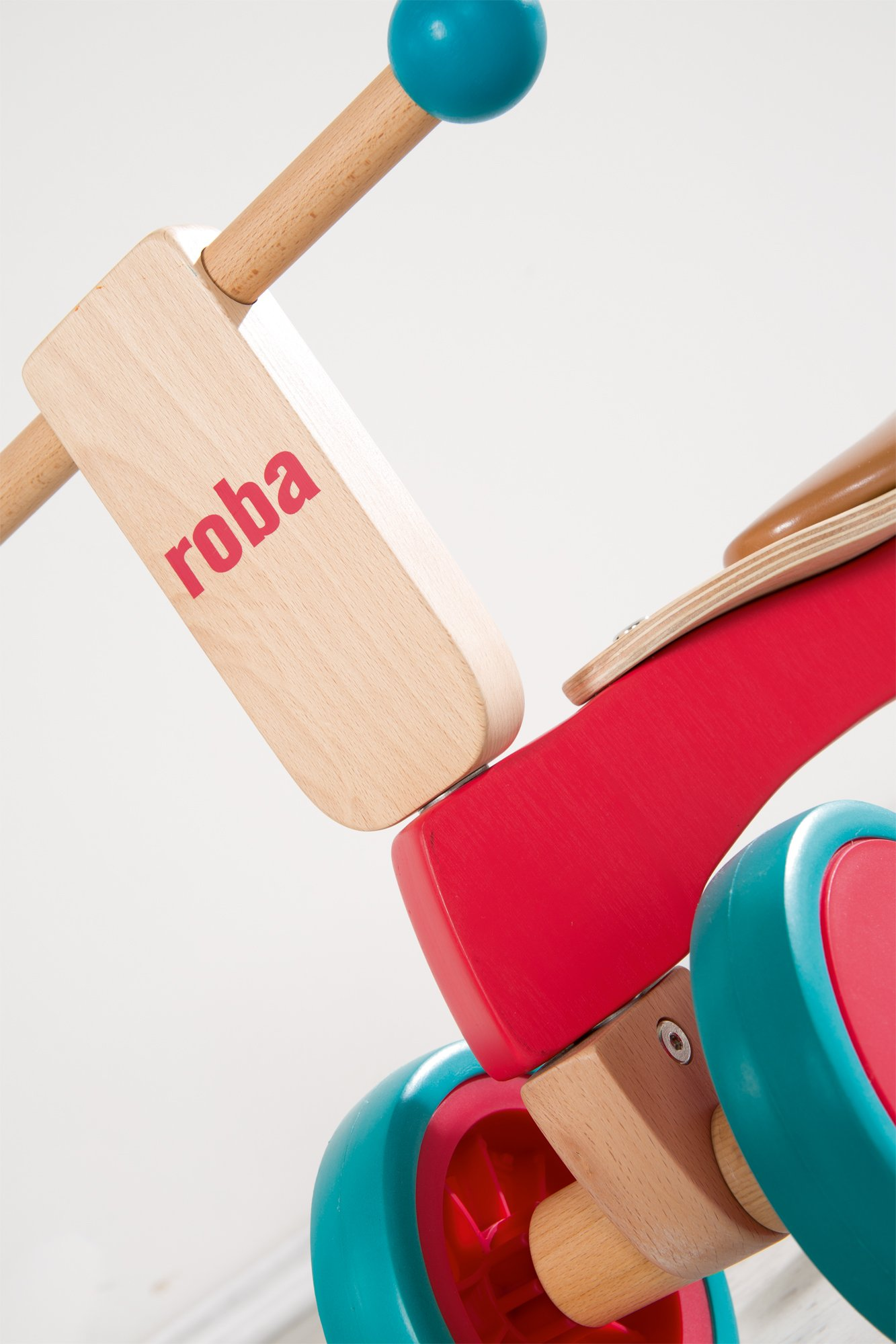 roba Wooden Vehicle for Toddlers from 1Year Old  This Roba wooden vehicle is the ideal learner's bicycle from toddlers of 12months and over to learn about balance and body coordination while having fun. The vehicle has a soft padded seat that is 22cm in height, and is suitable for children who are 80cm tall and over. The large coloured rubber tyres made from soft material (won't harm the floor) ensures a secure grip and is easy to move forward – for indoor and outdoor use. 4