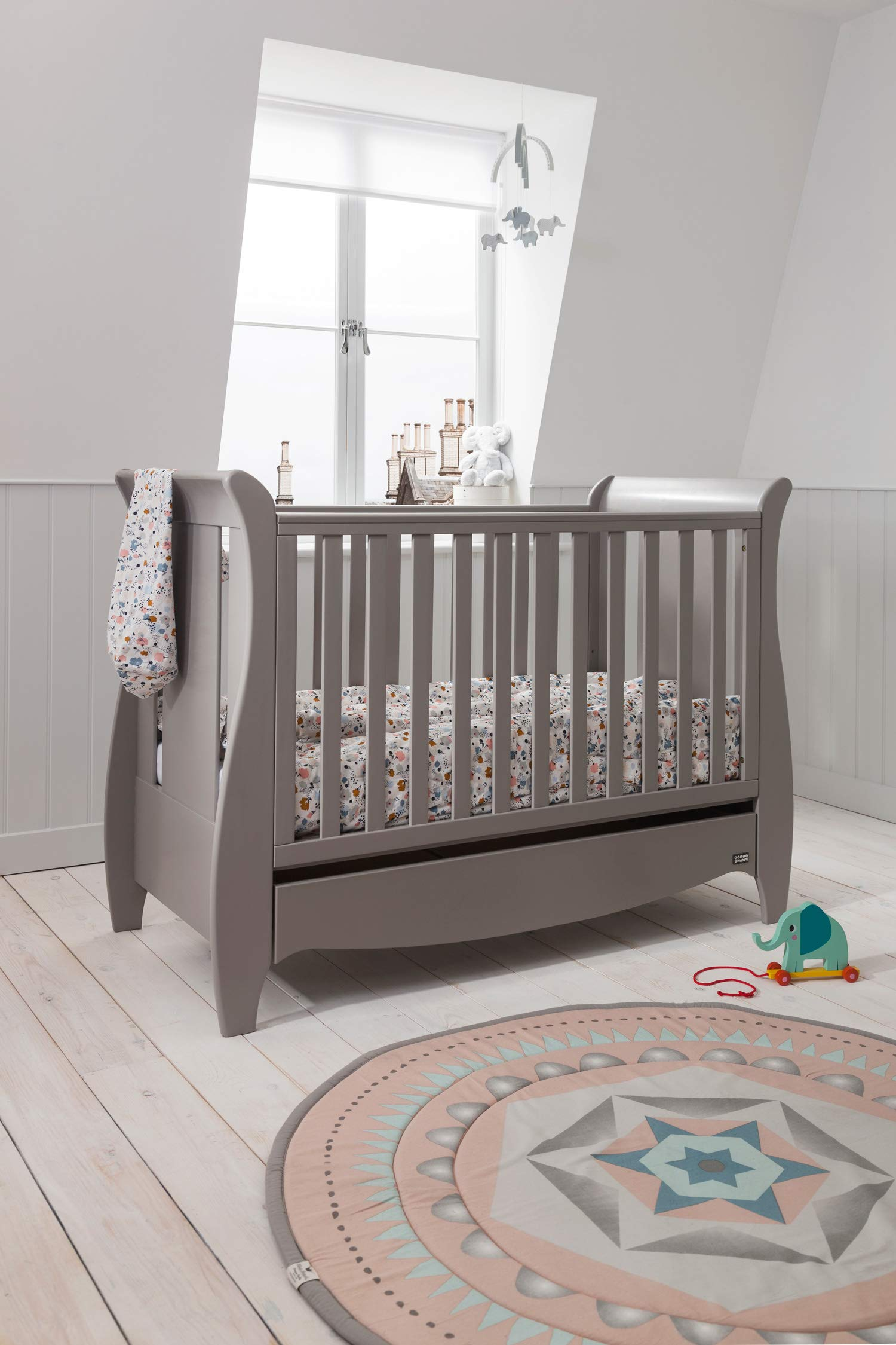 Tutti Bambini Roma Wooden Sleigh Cot Bed with Space Saver Under Bed Drawer - 120 x 60cm 3 Adjustable Positions (Truffle Grey) Tutti Bambini BIRTH TO 4 YEARS - Can be used as a Cot Bed from birth and then converted into a sofa or junior bed suitable up to 4 years ADJUSTABLE BASE - Three position adjustable mattress base, allowing easy access to little ones UNDER BED DRAWER - Classic sleigh design with under-bed drawer for extra storage, available in White or Espresso finish 4