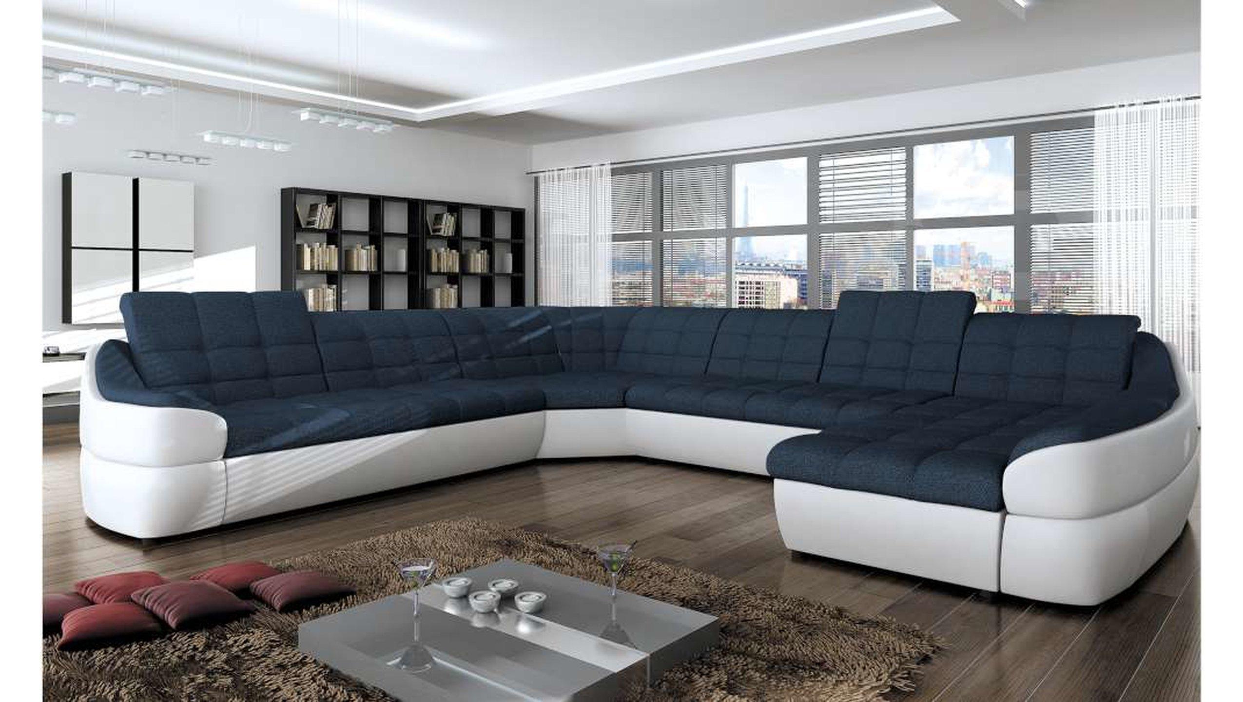 grande divano ad angolo blu e bianco, ideale per grandi salotti.