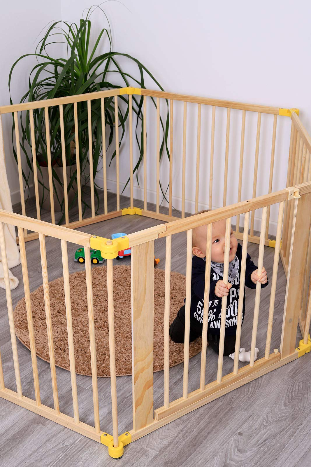 dibea DP00586 Baby Child Playpen, Wood, 270° Foldable incl. Door, 6 Panels Each 90x68cm dibea Wooden playpen with door, height 68 cm, 6 elements (including 1 door) each 90 x 68 cm (L, H). Distance between the single bars about 7, 5 cm 270 ° foldable, lockable form, flexibly usable as a playpen, protective grid, room divider or stair guard Rubber coating under the feet, so that the grid can not be moved by the baby 7