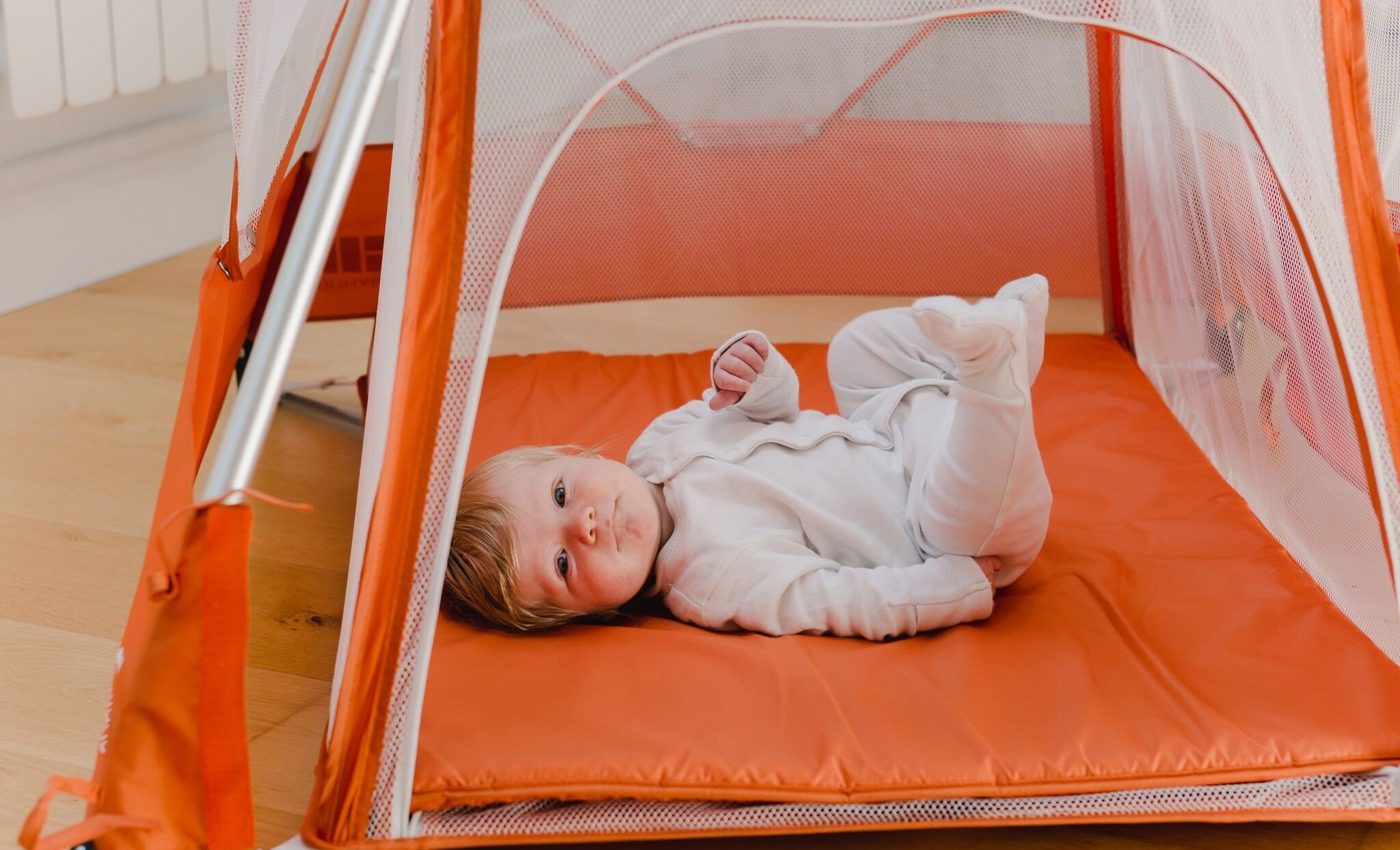 BabyHub SleepSpace Travel Cot with Mosquito Net, Orange BabyHub Three cots in one; use as a travel cot, mosquito proof space and reuse as a play tepee Includes extra mosquito net cover that can be securely in place Can be set up and moved even while holding a baby 5