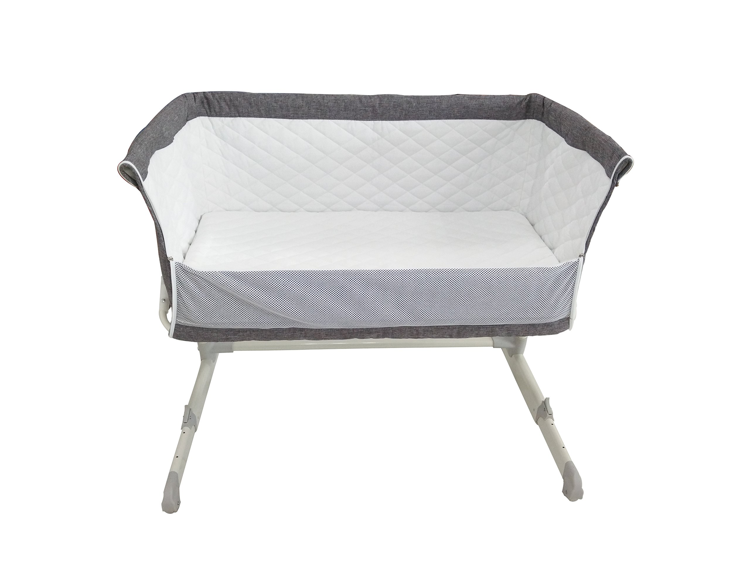 Babylo Cozi Sleeper  Complete with 2 Free Sheets worth £25 Pounds. Removable lining for easy cleaning. Storage Bag Included. European & UK Standard EN1130. Free from Chemicals.  Mattress Fatigue Test BS1877 Certified. Comes fitted with 2 wheels for easy manoeuvrability between rooms. Zip down side panel when fixing to the parents' bed for side-sleeping. Multi-height positions, individually adjustable on each side. Can be set inclined to help with congested breathing and reflux. Use from birth to 9kgs. Stop using when child can sit, kneel or pull themselves up unaided.  Fits both frame and divan beds as the design allows the crib to move flush with bed. Two fastening clip-on straps to hold crib snug against bed. As baby grows you can move it away from the bed and use as a normal crib. Removable and washable lining. Soft removable mattress included. 2 free sheets included. Soft quilted sides with mesh for visibility and ventilation. Easy manoeuvrability, assembly and use. Mattress size 87lx46wx4d. Handy storage bag for transportation. 4