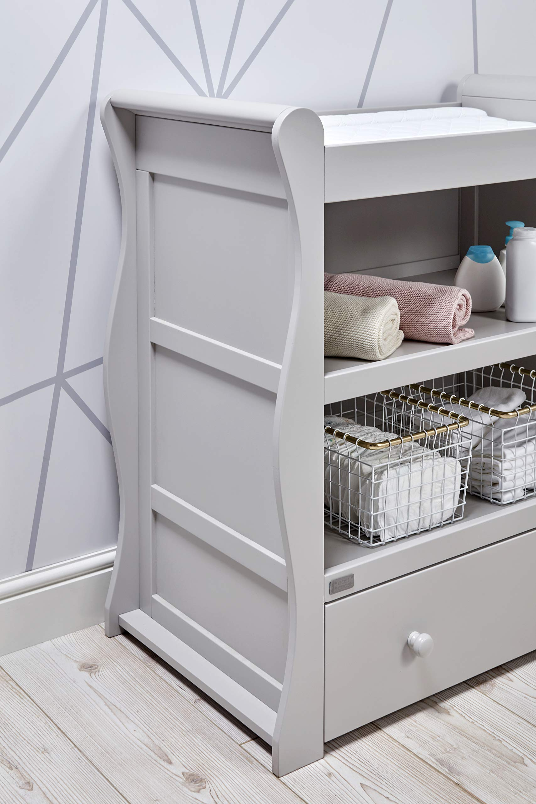 East Coast Nebraska Sleigh Dresser, Grey East Coast Integral changing area 1 Storage drawer 2 open storage areas 5