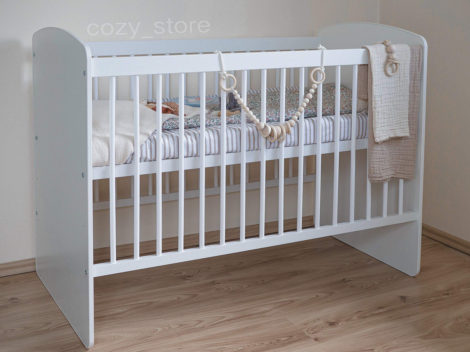 SOCOZY®   White Solid Pine Wood Baby Cot Bed I Free Healthy Coconut&BUCKWHEAT Mattress I Bed for Baby   3 Mattress Positions   ECO Paint   Minimalistic   120x60 SOCOZY ✔ HEALTH your growing child is the most important for us - The bed is made of ecological board and pine wood and the cot is covered with non-toxic lacquers ✔ ENJOY the view of the child playing in the cot and have a moment to yourself - as mom you deserve it more than anyone else ✔ GIVE YOUR CHILD a peaceful and helathy sleep - Coconut mat provides a flat, hard but also elastic support for the body while sleeping, perfect air circulation and humidity control. The mat is ecological. 1