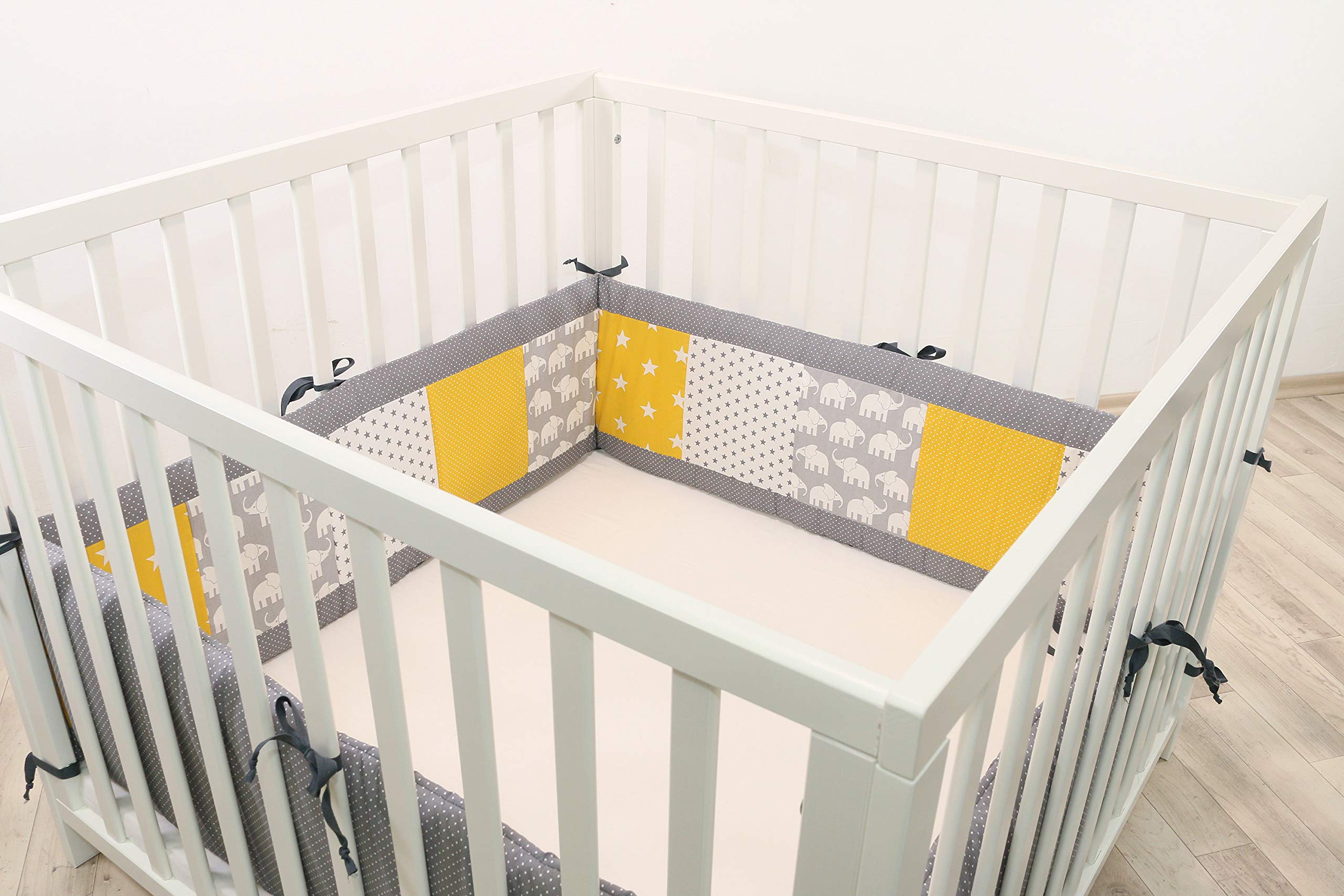 ULLENBOOM® Bumper- Yellow Elephants (400x 30cm Baby playpen Bumper, Full Surround Bumper Pads for 100x 100cm playpen) ULLENBOOM This 400x 30cm patchwork bumper serves as a protective insert and surround for 100x 100cm playpens, to provide babies with protection- especially head protection- from playpen bars The sizes 200x 30cm and 400x 30cm (full surround) are for playpens- the 'full surround' bumper comes in two sections. ULLENBOOM also offers additional sizes for 140x 70cm and 120x 60cm cots These bumpers can be washed at 30 °C and the materials used are certified according to the Oeko-Tex standard (tested for harmful substances, hypoallergenic); smooth outer fabric: 100% cotton (Oeko-Tex); soft, thick wadding: 100% polyester (Oeko-Tex) 1