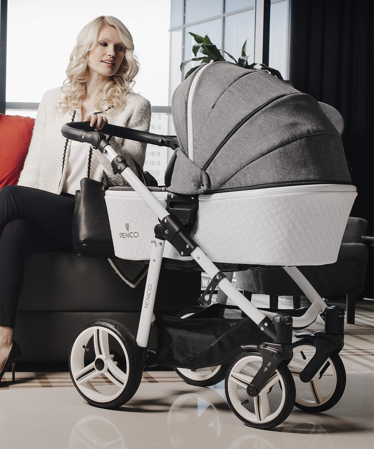 Venicci Pure 3-in-1 Travel System - Denim Grey - with Carrycot + Car Seat + Changing Bag + Apron + Raincover + Mosquito Net + 5-Point Harness and UV 50+ Fabric + Car Seat Adapters + Cup Holder Venicci 3 in 1 Travel System with included Group 0+ Car Seat Suitable for your baby from birth until 36 months 5-point harness to enhance the safety of your child 5